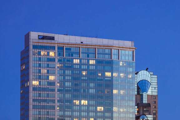 The northern facade of the Four Seasons hotel seen at dusk.�