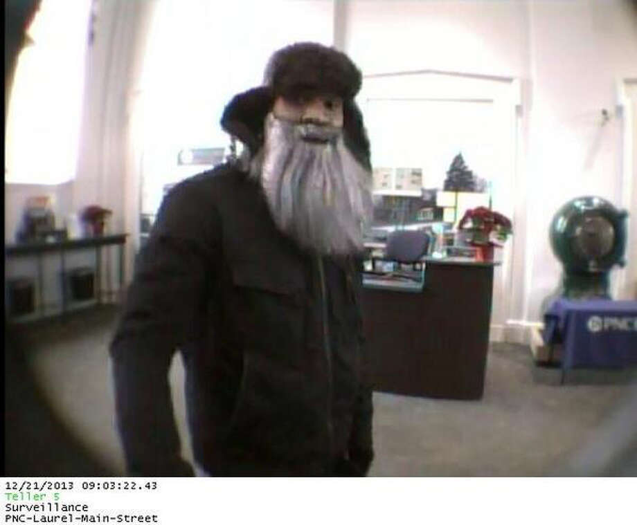 Security camera footage captures a man wearing a Santa-style beard as he fired shots and robbed a PNC bank in Laurel, Md., on Dec. 21, 2013.  Photo: Laurel Police Department.