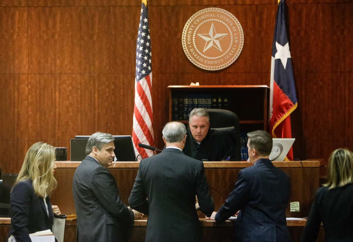 Attorneys for Backpage.com CEO Carl Ferrer and prosecutors talk with Judge Dan Spjut in Harris County Criminal Court 10, Friday, Oct. 7, 2016. Texas Attorney Gen. Ken Paxton weighed in on the case, saying Backpage.com is the largest advertiser of adult escort services in the U.S.