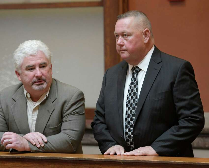 Gary Gordon, right speaks with private investigator Kevin M. Connolly at the Rensselaer County Courthouse before his court appearance Friday Oct. 7, 2016 in Troy, N.Y. (Skip Dickstein/Times Union)