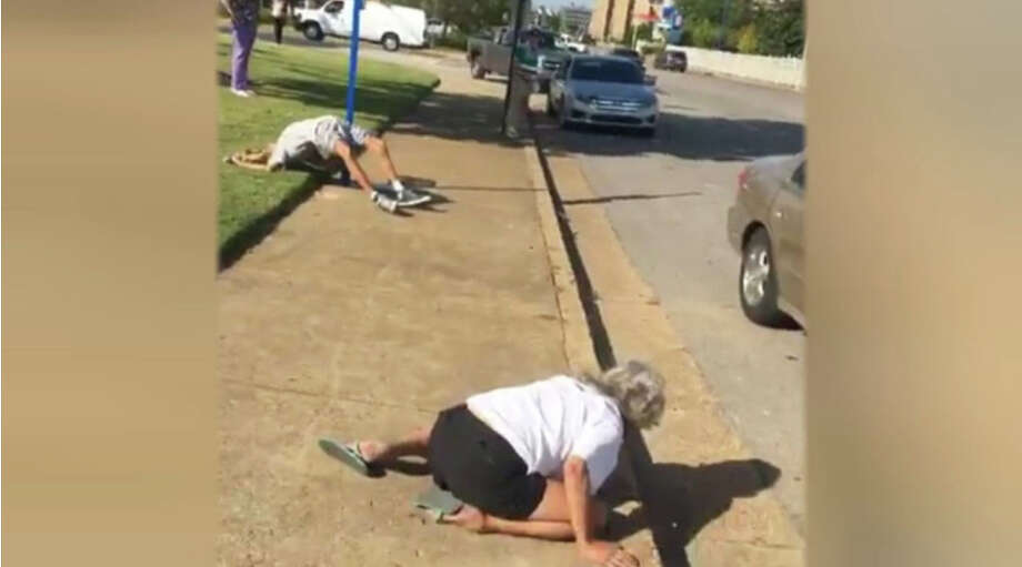 A Facebook Live video shows a man and woman later discovered to have overdosed on heroin lying unconscious on a Memphis, Tennessee, sidewalk as a crowd of people mocks and films them. Photo: Inside Edition