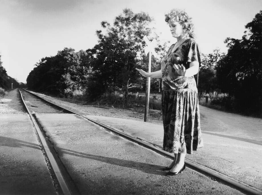 In this 1990 file photo, psychic consultant Elizabeth Paddon of Toronto tries to check a Southeast Side railroad crossing for ghostly vibrations. Although no records of a deadly bus accident at the crossing have ever surfaced, the tale of the 'ghost crossing' is widely considered San Antonio's most celebrated story of the macabre. Photo: Express-News File Photo / SAN ANTONIO EXPRESS-NEWS
