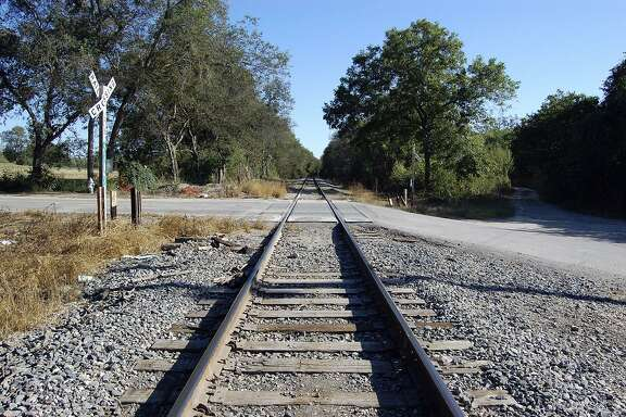 "These are the supposedly haunted ""ghost tracks"" near the intersection of Shane and Villamain roads where a busload of school children were reportedly killed in a collision with a train. The children's spirits are said to push cars out of danger, but no records of such a bus-train accident have ever been found."