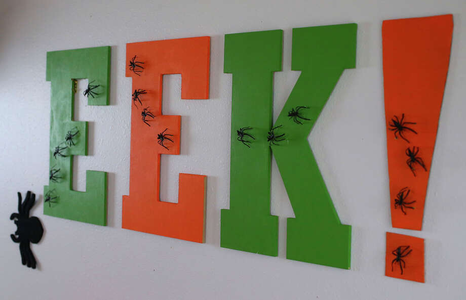 "An ""EEK!"" party sign out of letters from the craft store sets just right tone and theme for a Halloween party. Photo: John Davenport /San Antonio Express-News / ©San Antonio Express-News/John Davenport"
