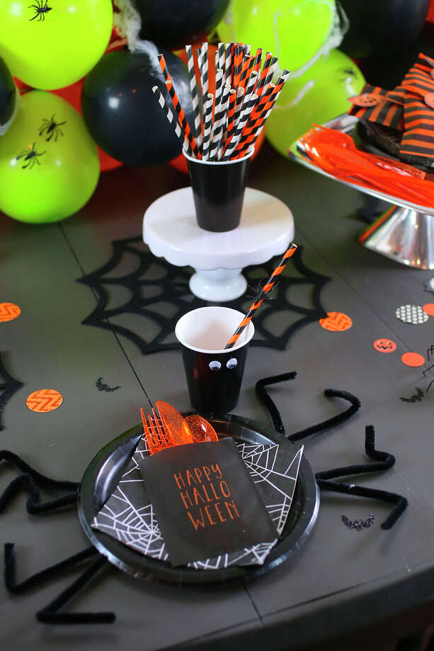 Simple paper plates and cups get a Halloween makeover with pipe cleaners and googly eyes. Photo: John Davenport /San Antonio Express-News / ©San Antonio Express-News/John Davenport