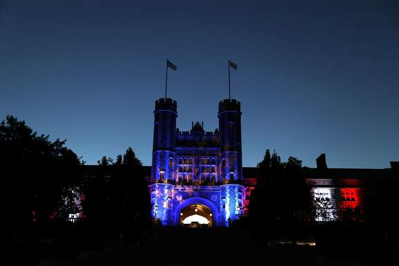 Brookings Hall is lit up in a patriotic theme as preparations continue ahead of the second presidential debate at Washington University in St. Louis, Thursday, Oct. 6, 2016. The town hall debate between Republican presidential nominee Donald Trump and Democratic presidential nominee Hillary Clinton is set for this Sunday. (AP Photo/Jeff Roberson)