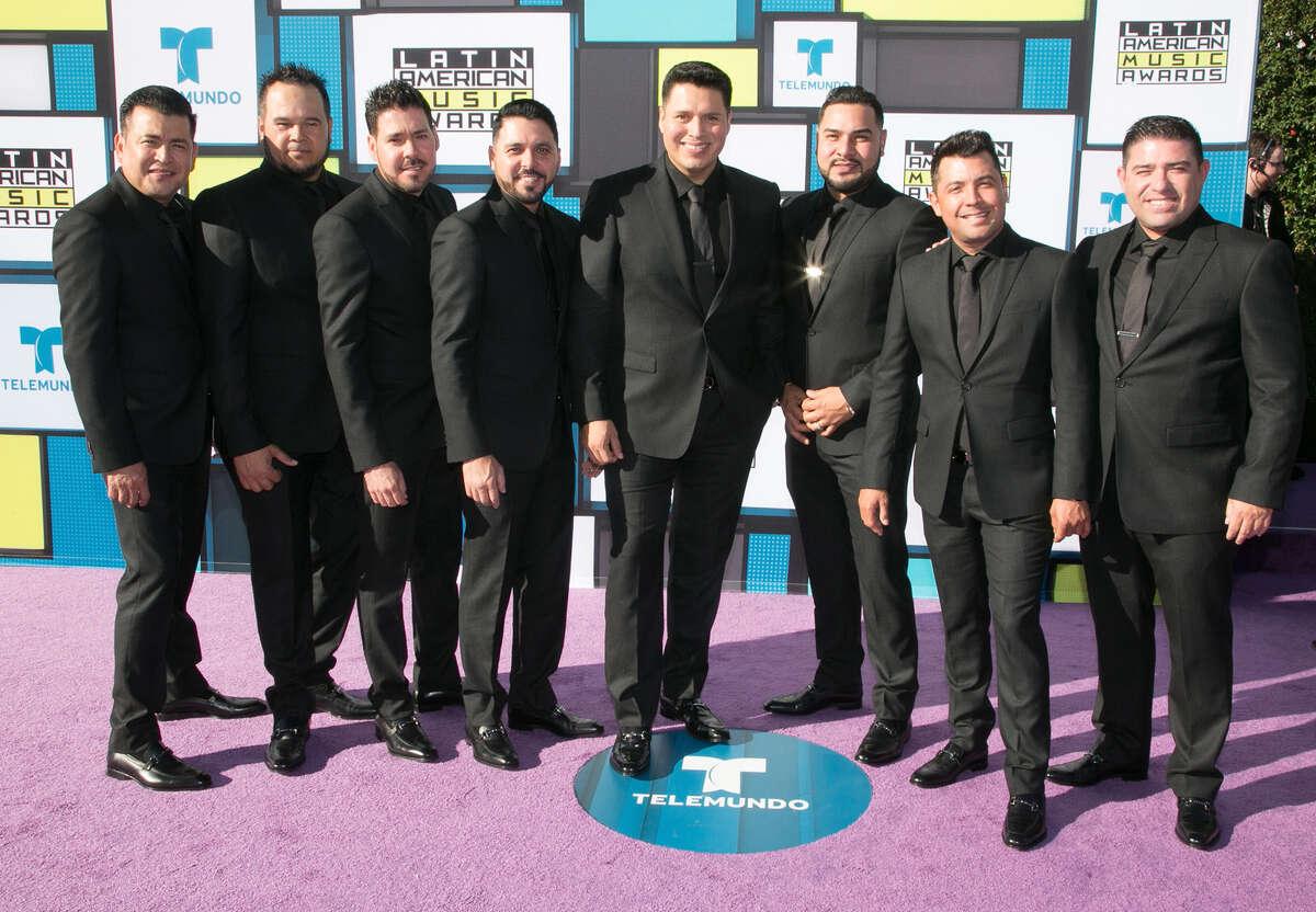 Sergio Lizarraga (L), Alan Ramirez (R), and members of Banda MS