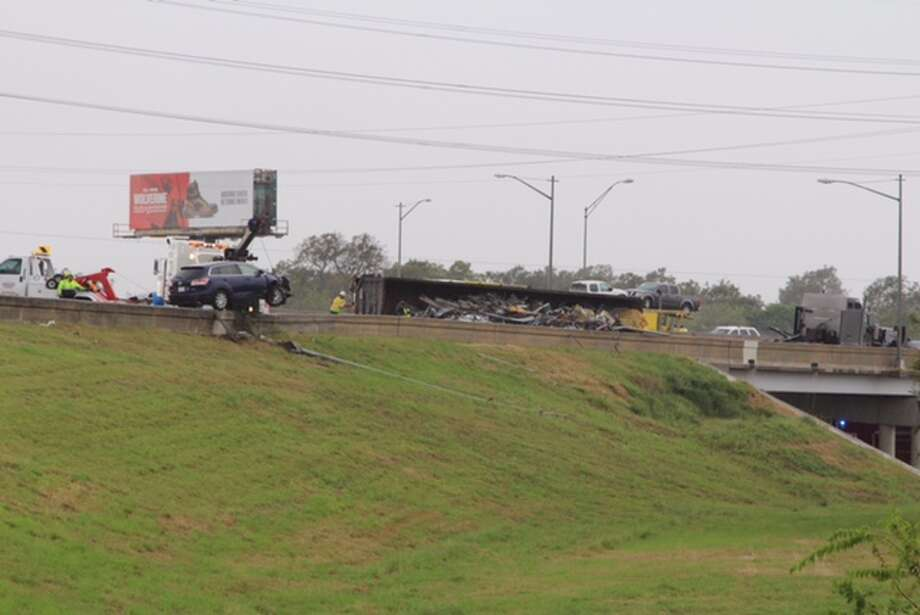 Police and emergency personnel responded to a two-vehicle crash involving an overturned 18-wheeler and an SUV on the westbound on-ramp to Interstate 10 from Interstate 37 on Oct. 7, 2016. Photo: San Antonio Express-News