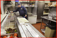 Scott Davis, a health inspector with the state of Maine, looks over a food prep area in the kitchen at the Stage Neck Inn in York during an inspection on Thursday, March 14, 2013.