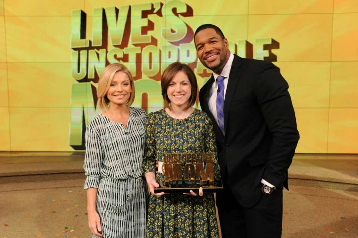 Kelly Ripa and Michael Strahan talk with Lauren Perkins during the production of