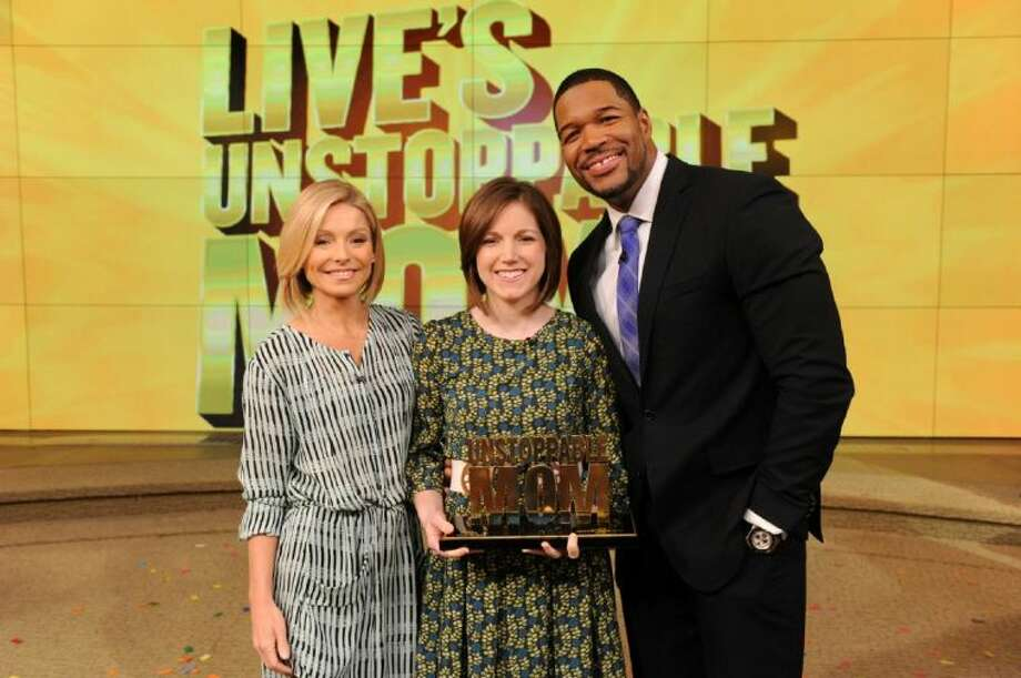 "Kelly Ripa and Michael Strahan talk with Lauren Perkins during the production of ""Live! with Kelly and Michael"" in New York on Monday, March 10, 2014. Photo: David M. Russell/Disney ABC©2014 Disney ABC. All Rights Reserved Photo: David M. Russell"