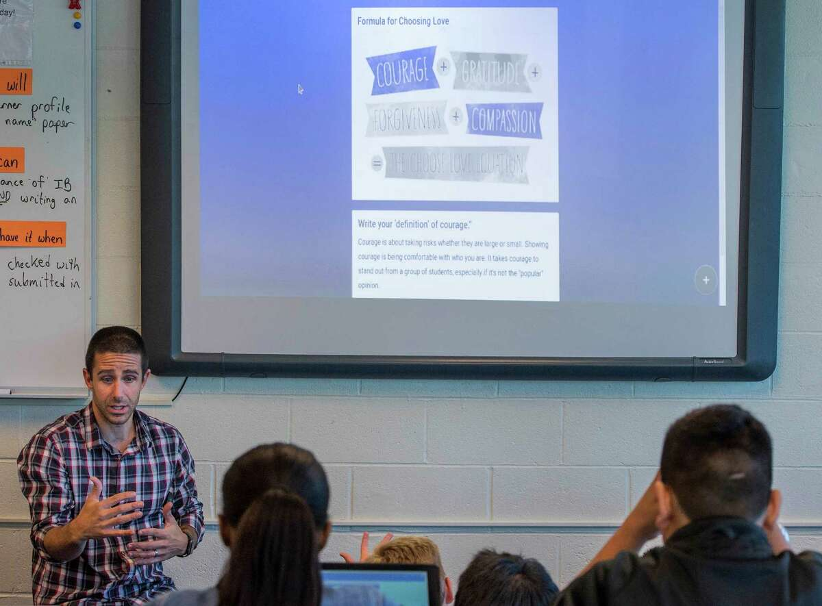 """6th grade teacher Jimmy Sapia teaches the """"Choose Love Enrichment"""" curriculum to his class at Rippowam Middle School, Stamford."""