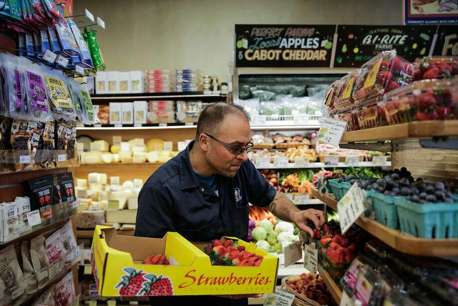 Sam Mogannam, owner of Bi-Rite grocery re-stocks the strawberries at the Bi-Rite in the Mission, in San Francisco, California, on Wednesday, Oct. 5, 2016. Photo: Gabrielle Lurie, The Chronicle