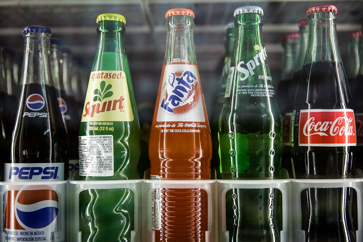 Bottles of soda rest in the refrigerator at Mi Rancho Produce in the Mission District, in San Francisco, California, on Wednesday, Oct. 5, 2016.
