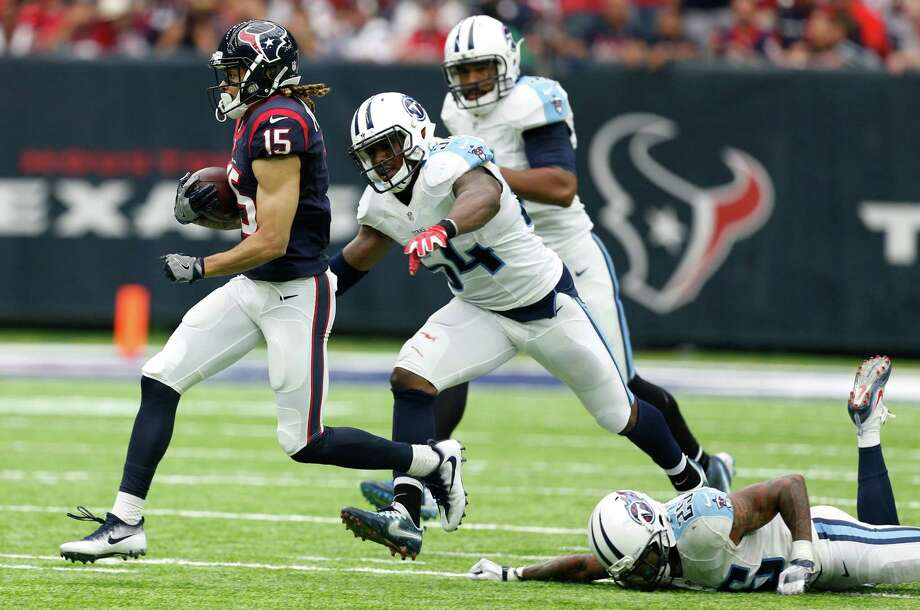 Houston Texans wide receiver Will Fuller (15) runs past Tennessee Titans free safety Rashad Johnson (25) and  inside linebacker Avery Williamson (54) for a 14-yard reception during the first quarter of an NFL football game at NRG Stadium on Sunday, Oct. 2, 2016, in Houston. ( Brett Coomer / Houston Chronicle ) Photo: Brett Coomer, Staff / © 2016 Houston Chronicle