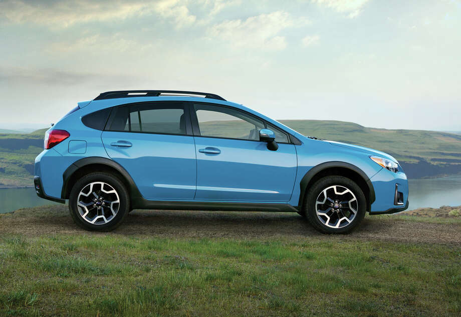 Subaru has standardized on 17-inch alloy wheels for all versions of the Crosstrek. The five-door has a distinctive 8.7 inches of ground clearance, measured at the front crossmember. Photo: Subaru / Ã2015 Dana Neibert