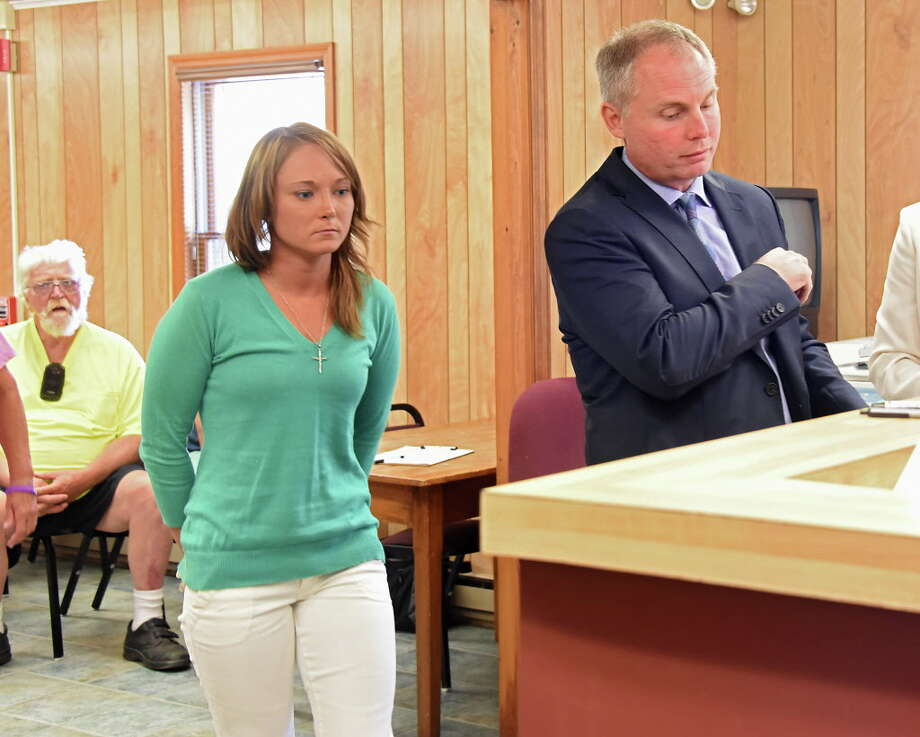 Rachael Mattice, 24, and her attorney Robert Abdella, right, approach the bench of Judge John Papa to plead not guilty on Tuesday, Aug. 9, 2016 in Mayfield, N.Y. Mattice was arrested on 1 misdemeanor count of Falsely reporting an incident in the third degree, accused of making up the story about her abduction from the town of Wells. (Lori Van Buren / Times Union) Photo: Lori Van Buren / 20037426A