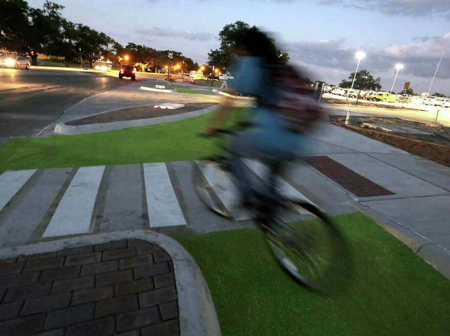 "Texas A&M is experimenting with glow-in-the-dark bike lanes and ""Dutch junctions"" on campus. Photo: Elizabeth Conley, Houston Chronicle / © 2016 Houston Chronicle"