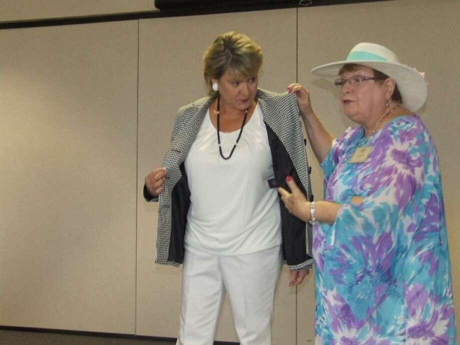 Harriet Fetcher presents Mayor Gretchen Fagan at the Tomball Study Club annual style show on Tuesday, April 8.