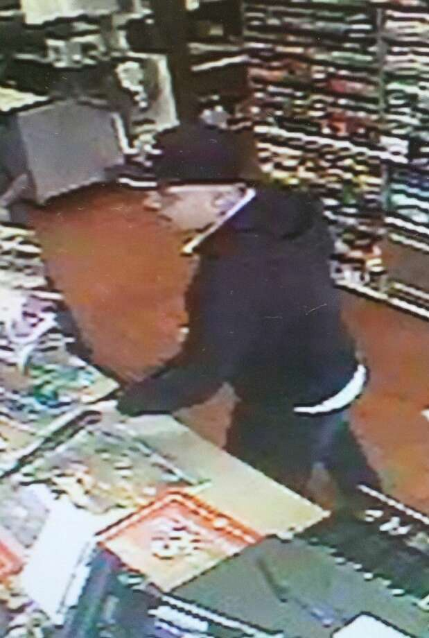 A lone gun man robbed Pogies convenience store located at 6602 Broadway Sunday (Oct. 12). Pearland Police are asking for the public's help to track down the robber. Photo: Courtesy Pearland Police