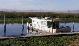 A houseboat is docked at the Holland Riverside Marina on Rock Slough in Brentwood, Calif. on Friday, Oct. 7, 2016. A study released by the Bay Institute shows a dramatic decrease in river water levels flowing into the bay delta.