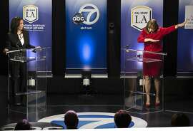 """In this Wednesday, Oct. 5, 2016 photo, Rep. Loretta Sanchez, D-Orange, right, does the """"dab"""" at the conclusion of her debate with state Attorney General Kamala Harris, left, in Los Angeles. The Orange County congresswoman capped an hour-long debate with her fellow Democrat by mimicking a celebratory gesture popularized by NFL star Cam Newton. (Ed Crisostomo/The Orange County Register via AP)"""