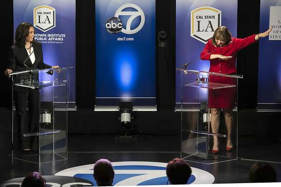 "In this Wednesday, Oct. 5, 2016 photo, Rep. Loretta Sanchez, D-Orange, right, does the ""dab"" at the conclusion of her debate with state Attorney General Kamala Harris, left, in Los Angeles. The Orange County congresswoman capped an hour-long debate with her fellow Democrat by mimicking a celebratory gesture popularized by NFL star Cam Newton. (Ed Crisostomo/The Orange County Register via AP)"