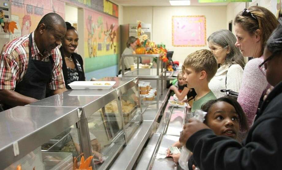 COCISD Director of Maintenance Johnny Washington and JSE Asst. Principal Myra Richardson serve a feast to James Street Elementary students and their families for the JSE Thanksgiving Luncheon on Thursday, Nov. 13. Photo: Cassie Gregory