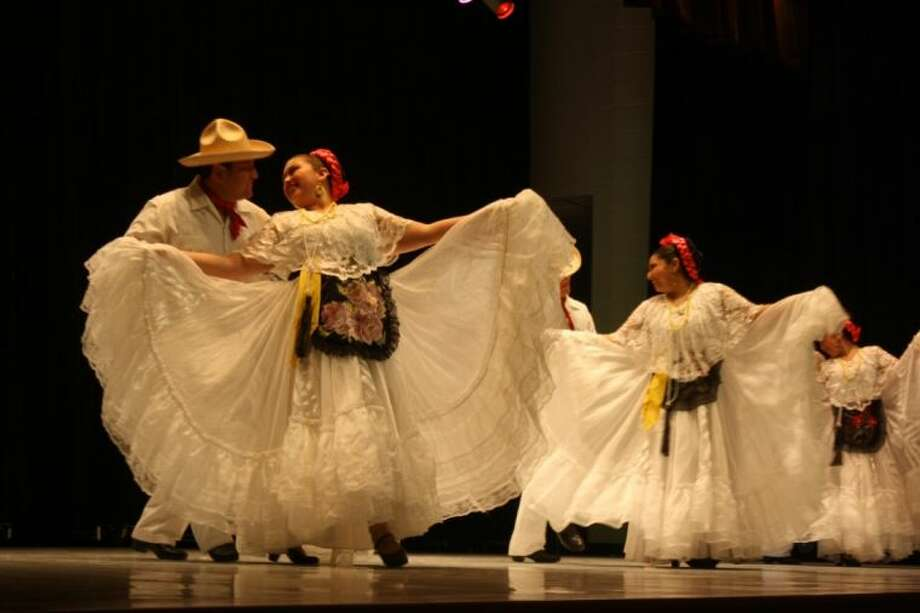 The Ambassadors International Ballet Folklorico took the stage for a Cinco de Mayo performance that brought traditional dances from four Mexican states - Jalisco, Vera Cruz, Guerrero and Sonora to Genoa Elementary last Monday evening. Photo: Y.C. OROZCO