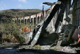 The Bayshore Roundhouse, which was once a hub on the old Southern Pacific railyard, sits abandoned and decaying on open space land between Bayshore Boulevard and Highway 101 in Brisbane, Calif. on Thursday, Sept. 3, 2015. The historic roundhouse will be restored as part of the Baylands mixed-use development project which is planned for the 660-acre site.