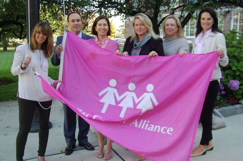 From left, BCA Executive Director Yonni Wattenmaker, First Selectman Peter Tesei, Go For Pink Chairman Loren Taufield, Trish Kirsch, Nancy Smith and Mary Jeffrey, vice president of the BCA's Board of Directors at the third annual flag raising Thursday to kick off Breast Cancer Awareness Month and fund-raising projects by Greenwich's Breast Cancer Alliance. Photo: Ken Borsuk