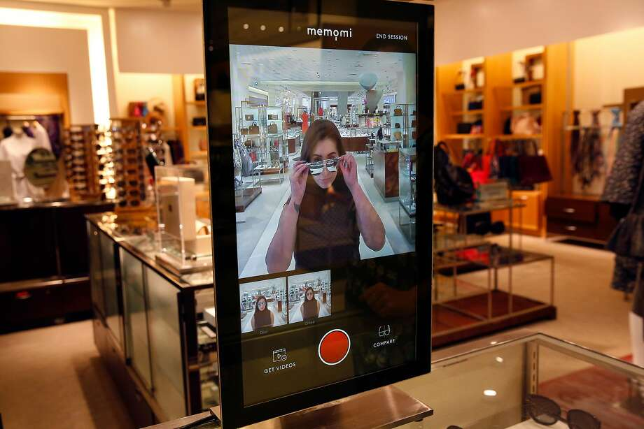 Alysa Stefani, a sales manager, demonstrates the Memory Mirror, which allows shoppers to try on sunglasses and compare photos of them side by side. Photo: Leah Millis, The Chronicle
