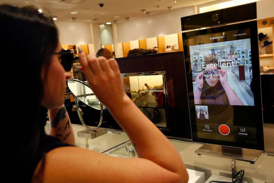 Alysa Stefani, sales manager, demonstrates how to use a digital mirror in the sunglasses area in Neiman Marcus in San Francisco. Photo: Leah Millis, The Chronicle