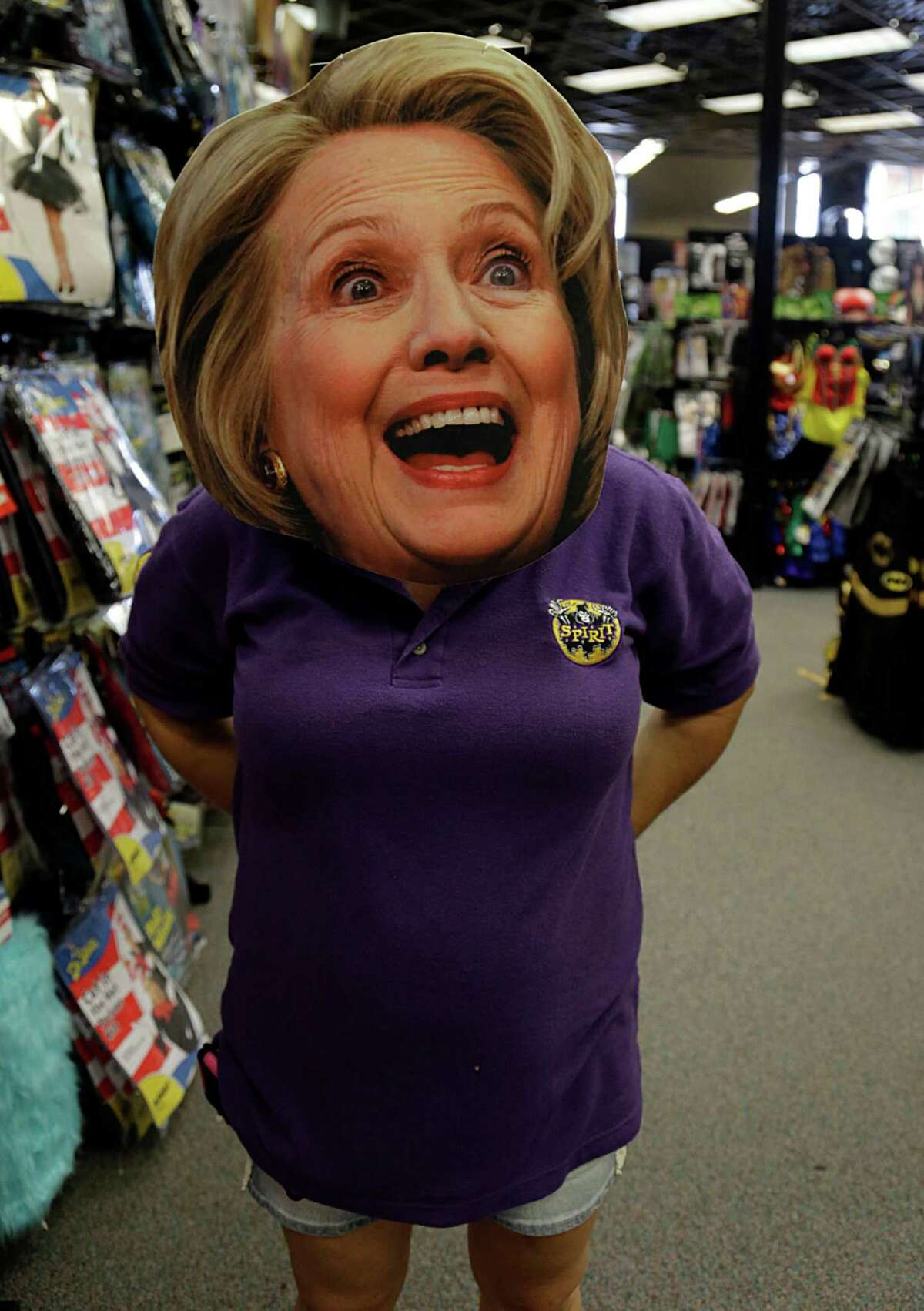 A Spirit Halloween store, manager wears a Hillary Clinton mask Oct. 7, 2016, in Houston.