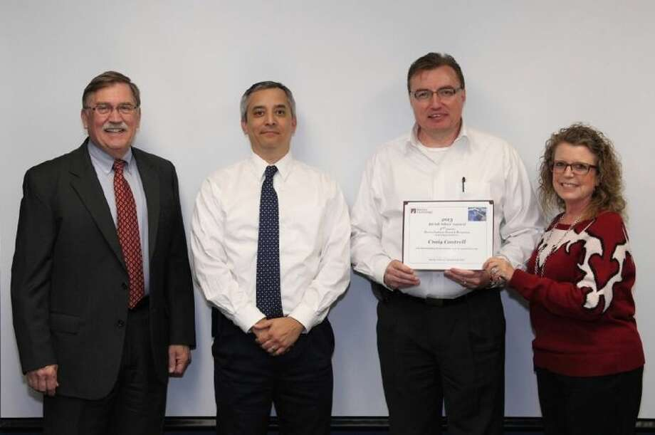 Craig Cantrell was presented a 3rd Quarter Silver Bear Award. Pictured from left are LD Stevenson, Barrios Teammate Principal, JETS Contract; Eric Heddles; Craig Cantrell; and Sandy Johnson, President & CEO Barrios Technology.