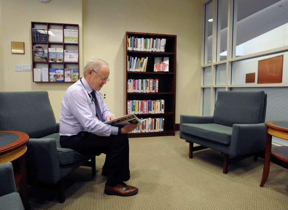 Dr. Steven Mickley, the namesake of the Dr. Steven Mickley Community Health Resource Section of the Medical Library at Greenwich Hospital, reads a medical book in the library at Greenwich Hospital, Conn., Friday, Oct. 7, 2016. The library was a gift from an anonymous donor who named it in honor of Dr. Mickley, a physician who has practiced in Greenwich for more then 30 years. The library is located in the hospital at 5 Perryridge Road in Greenwich and is open to the public. Photo: Bob Luckey Jr. / Hearst Connecticut Media / Greenwich Time