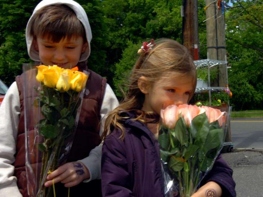 Stefan Probis, 7 and his sister Claire, 4, look for flowers at the Cos Cob Farm for Mother's Day, on Sunday, May 9, 2010.