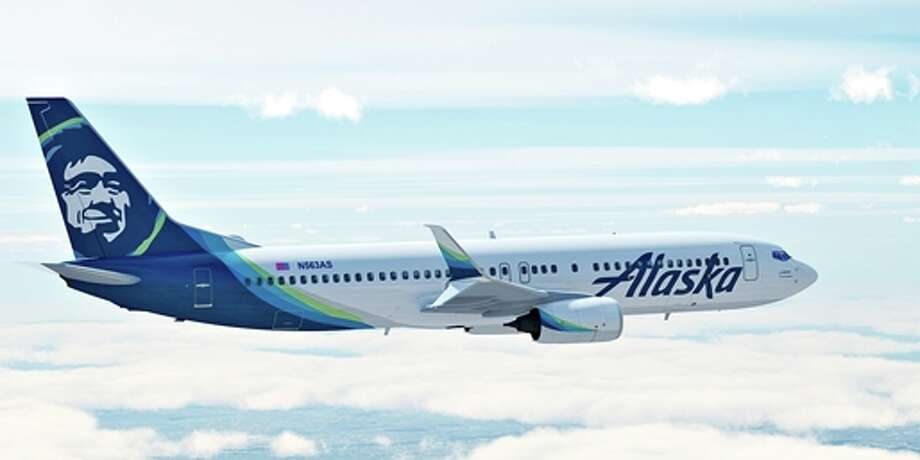 An Alaska Airlines flight to Seattle was forced to return to Anchorage early Wednesday after a passenger locked himself in the bathroom, took off all his clothes, and refused to follow crew instructions.