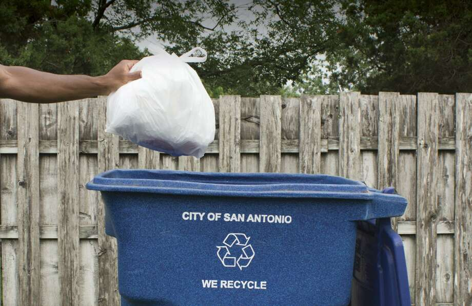 This file photo from the city illustrates how the city wants the public to recycle their plastic bags in blue bins. Fewer and fewer people have continued to wad up their plastic bags into the size of a soccer ball, making the numbers plunge. Photo: Courtesy /