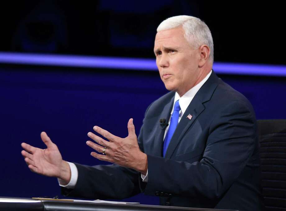 Republican vice presidential nominee Mike Pence, who talks about his deep religious faith on the campaign trail, has twisted himself into pretzels trying to explain away Donald Trump's excesses. Photo: Bao Dandan / Xinhua /TNS / Sipa USA