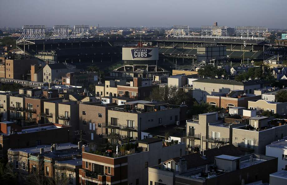 Wrigley Field sits in the center of Wrigleyville, a vibrant residential neighborhood. Photo: Kiichiro Sato, Associated Press