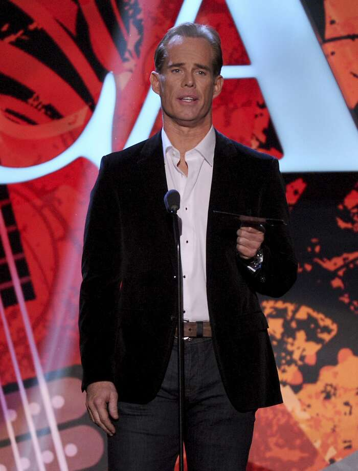 FILE - In this Dec. 10, 2013, file photo, Joe Buck speaks on stage at the American Country Awards at the Mandalay Bay Resort & Casino in Las Vegas. Sports Illustrated reported on Oct. 6, 2016, that in a new memoir, Buck writes that nerve damage he sustained during hair restoration surgery was responsible for a vocal cord injury he battled in 2011. (Photo by Frank Micelotta/Invision/AP, File) Photo: Frank Micelotta, Associated Press