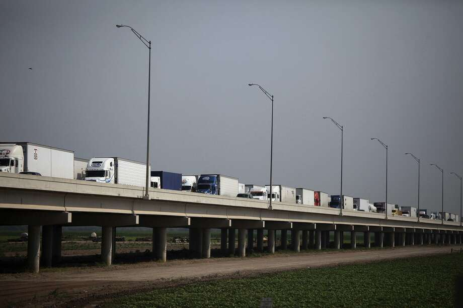 This 2011 file photo shows trucks waiting on the Pharr-Reynosa International Bridge to enter the United States and for their trucks and loads to be inspected by Customs and Border Protection Agriculture Specialists at the Pharr-Reynosa International Bridge. Photo: San Antonio Express-News /File Photo / SAN ANTONIO EXPRESS-NEWS