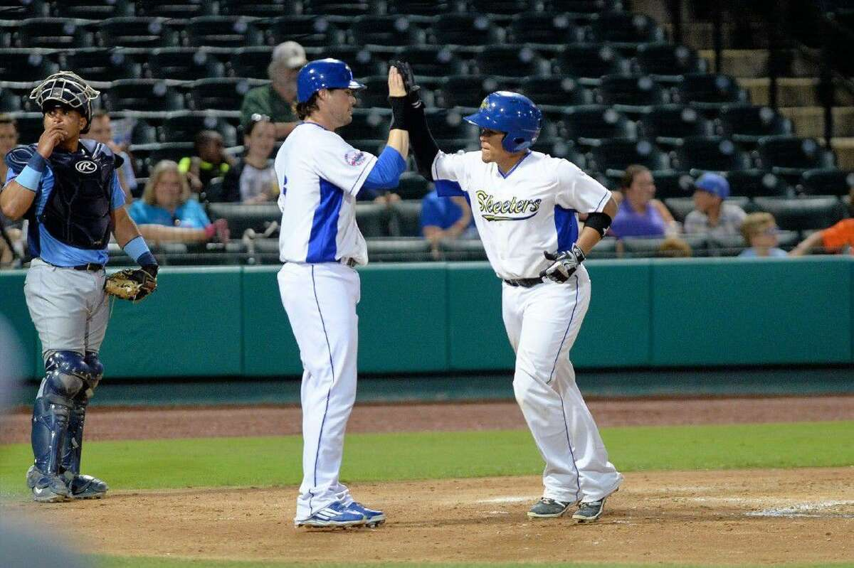 Patrick Palmeiro high fives Wilfredo Rodriguez after a home run against Southern Maryland this season. The Sugar Land Skeeters swept the Blue Crabs to close the regular season and clinch a playoff spot.