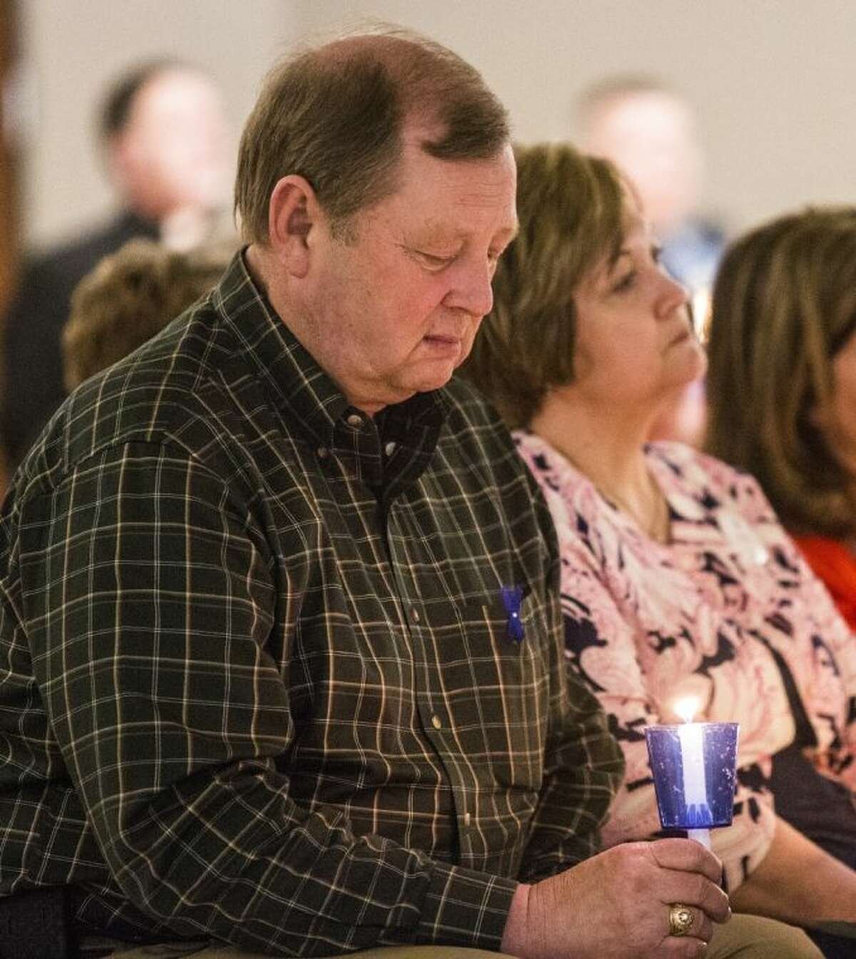 State Rep. John Otto is solemn during a candlelight vigil in recognition of Child Abuse Prevention Month and Crime Victims' Rights Week on April 8, 2014, at Liberty Center.