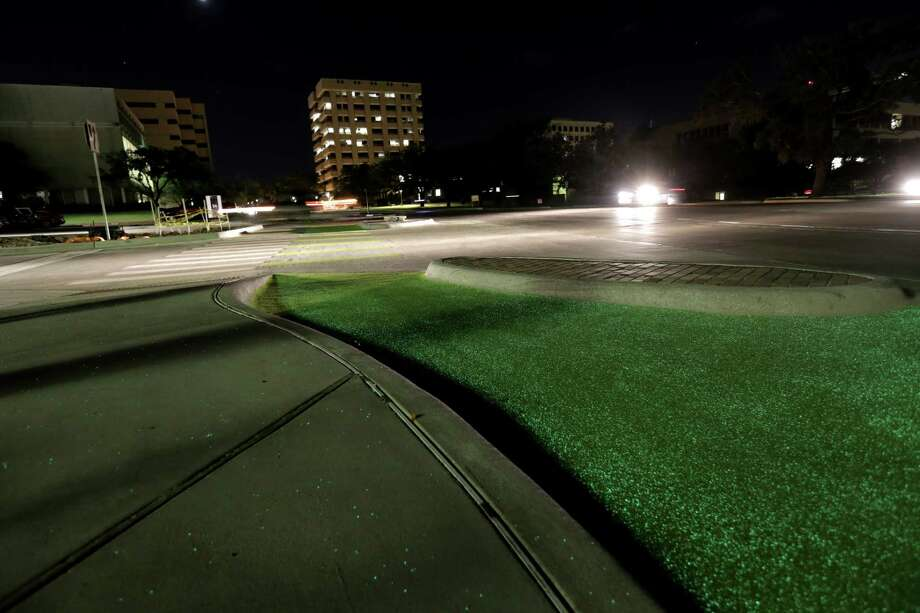 Texas A&M is experimenting with glow-in-the-dark bike lanes at the intersection of Bizzell and Ross Streets, as seen on Oct. 5 in College Station. Photo: Elizabeth Conley, Staff / © 2016 Houston Chronicle