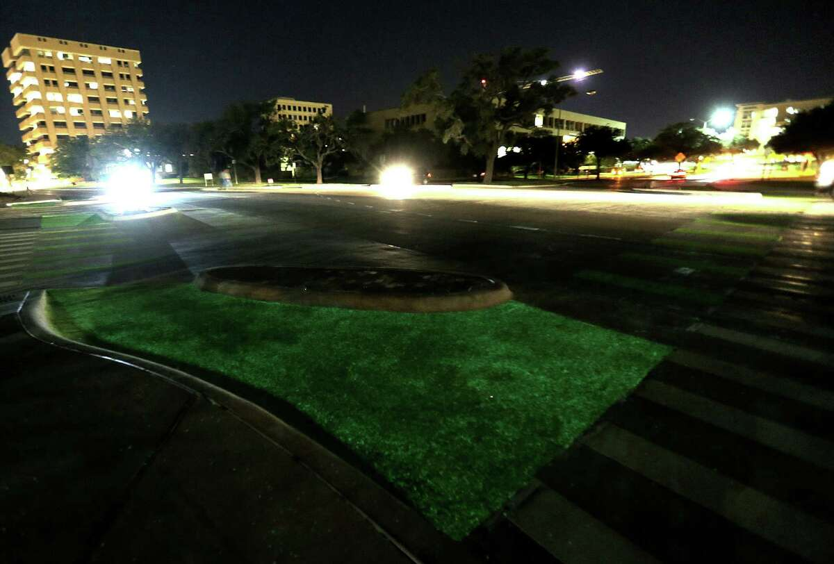 Texas A&M is experimenting with glow-in-the-dark bike lanes at the intersection of Bizzell and Ross Streets, as seen on Oct. 5 in College Station.