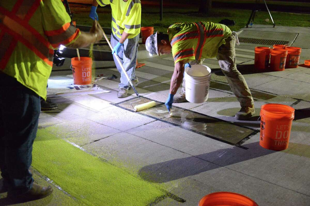 Crews reconfigured the intersection of Bizzell and Ross on the Texas A&M main campus as part of a test of bicycling and driving safety elements. Part of the test includes use ofsolar luminescent paint, which will glow at night.