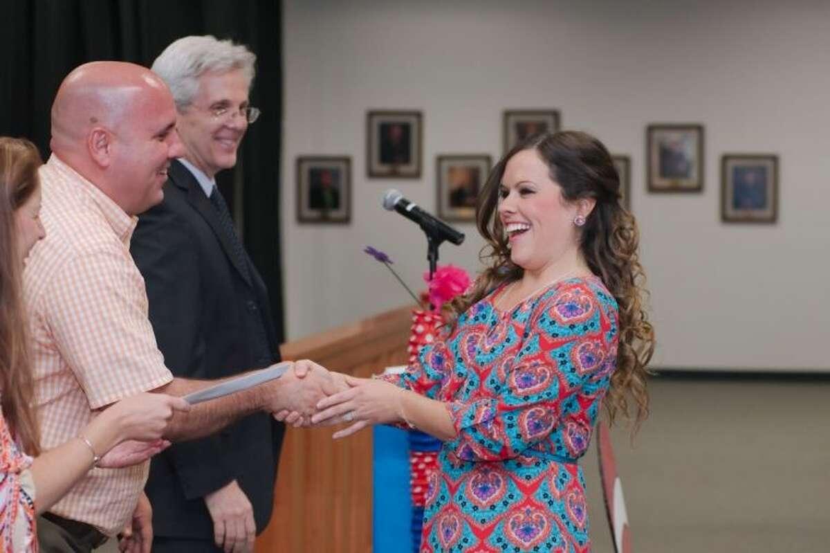Dawson High School Teacher Laura Dunham receives the Glenda Dawson First-Year Secondary Teacher award during the 2014 Pearland Independent School District Employee Awards Celebration Friday, May 3.