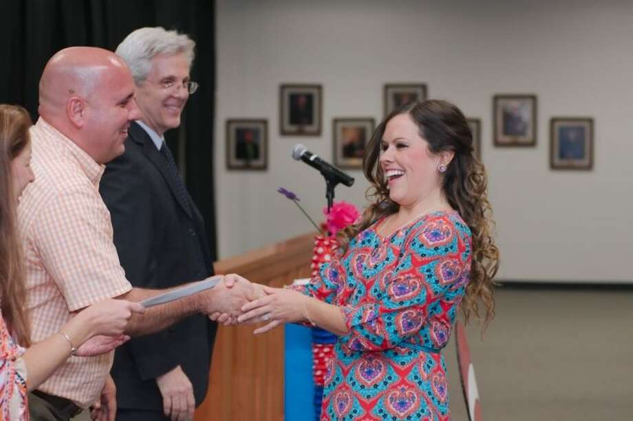 Dawson High School Teacher Laura Dunham receives the Glenda Dawson First-Year Secondary Teacher award during the 2014 Pearland Independent School District Employee Awards Celebration Friday, May 3. Photo: KIRK SIDES